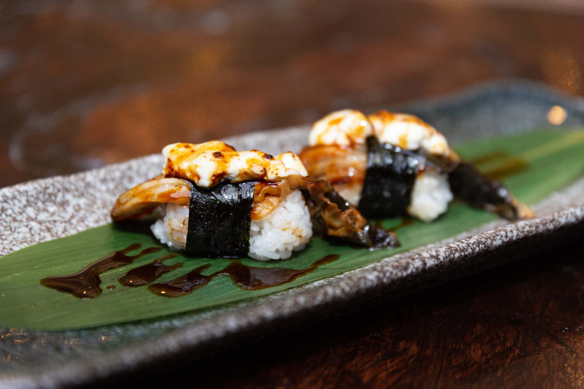Grilled eel nigiri with goat's cheese