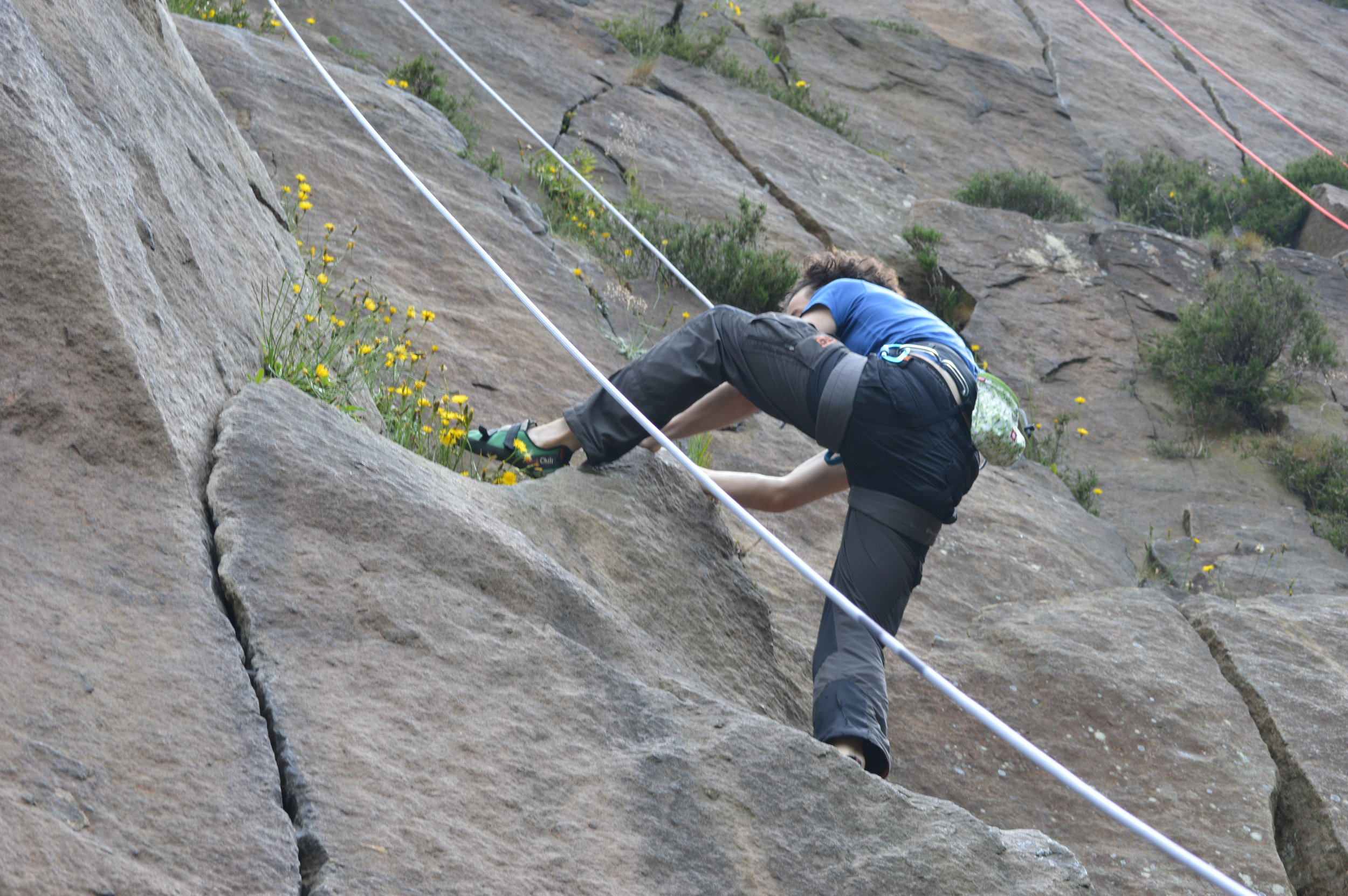 Chris climbing in the Peak District.  Photo by Georgie Bull.