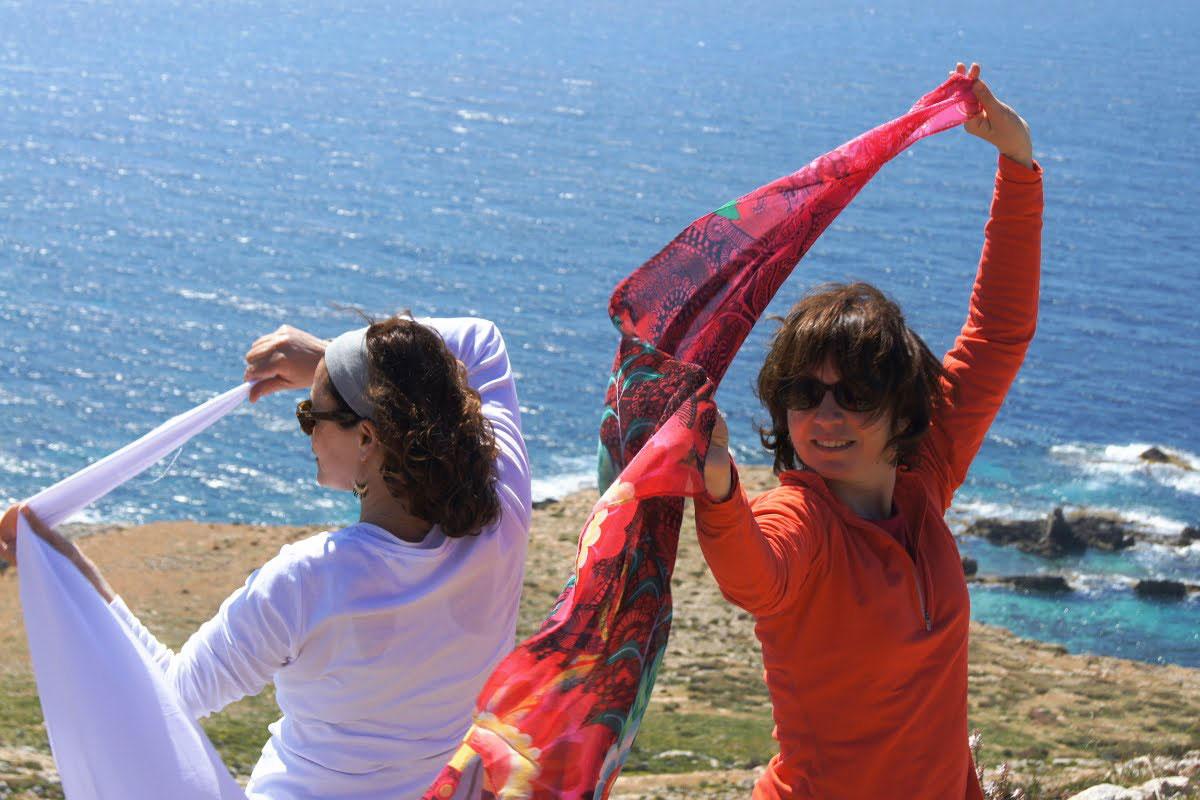 two-women-white-and-orange-againt-sea.jpg