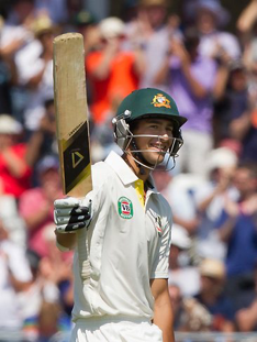 Ashton Agar salutes the crowd following his debut innings