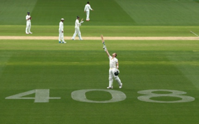 Steve Smith salutes after his century on the 408 sign