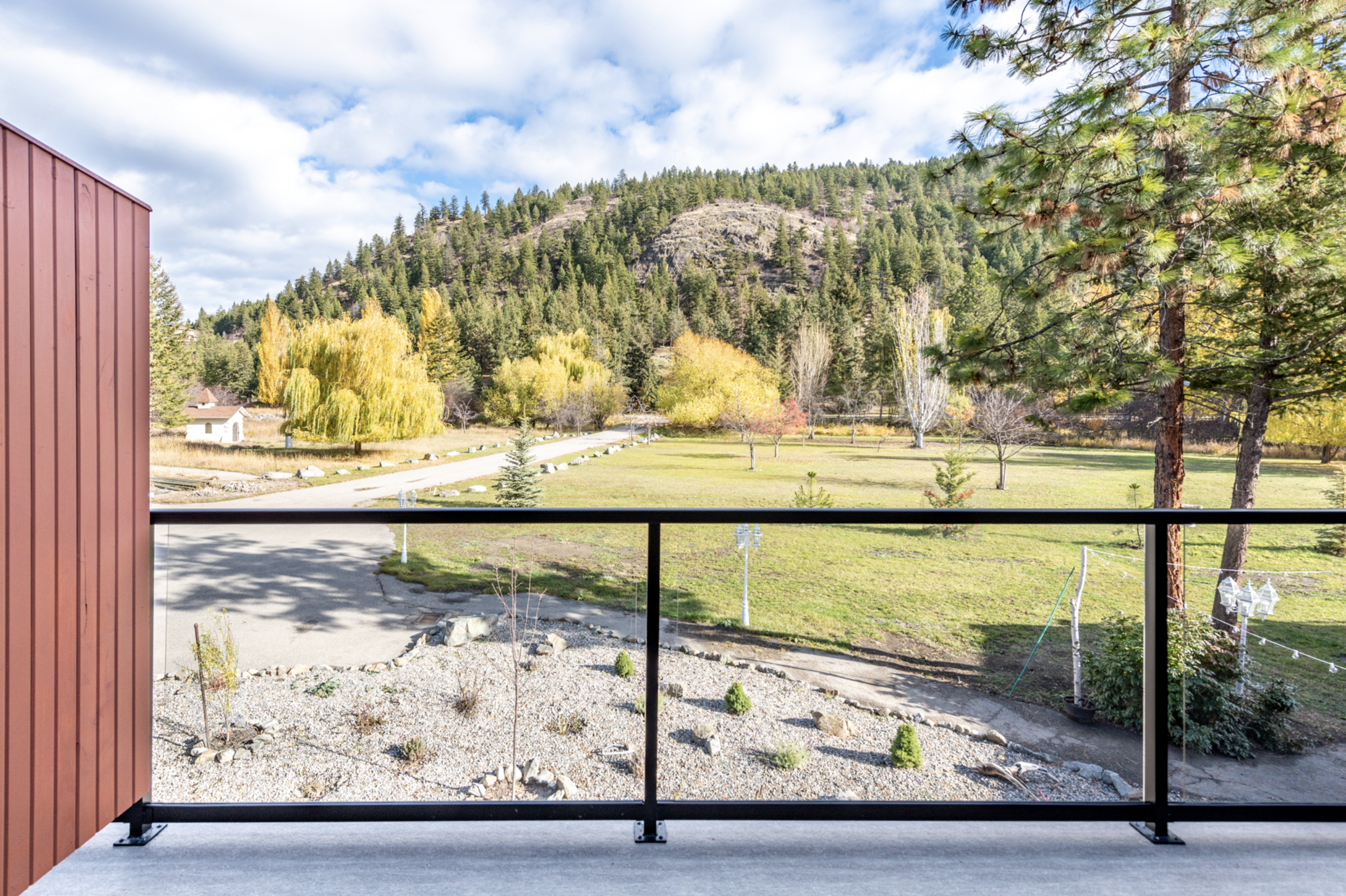 Guest suite - 3,500 square feet with 5 large bedrooms, 5 private washrooms, a common living and kitchen space, laundry, and 5 private patio spaces to enjoy the incredible view of Deer Park and the Monashee Mountains.