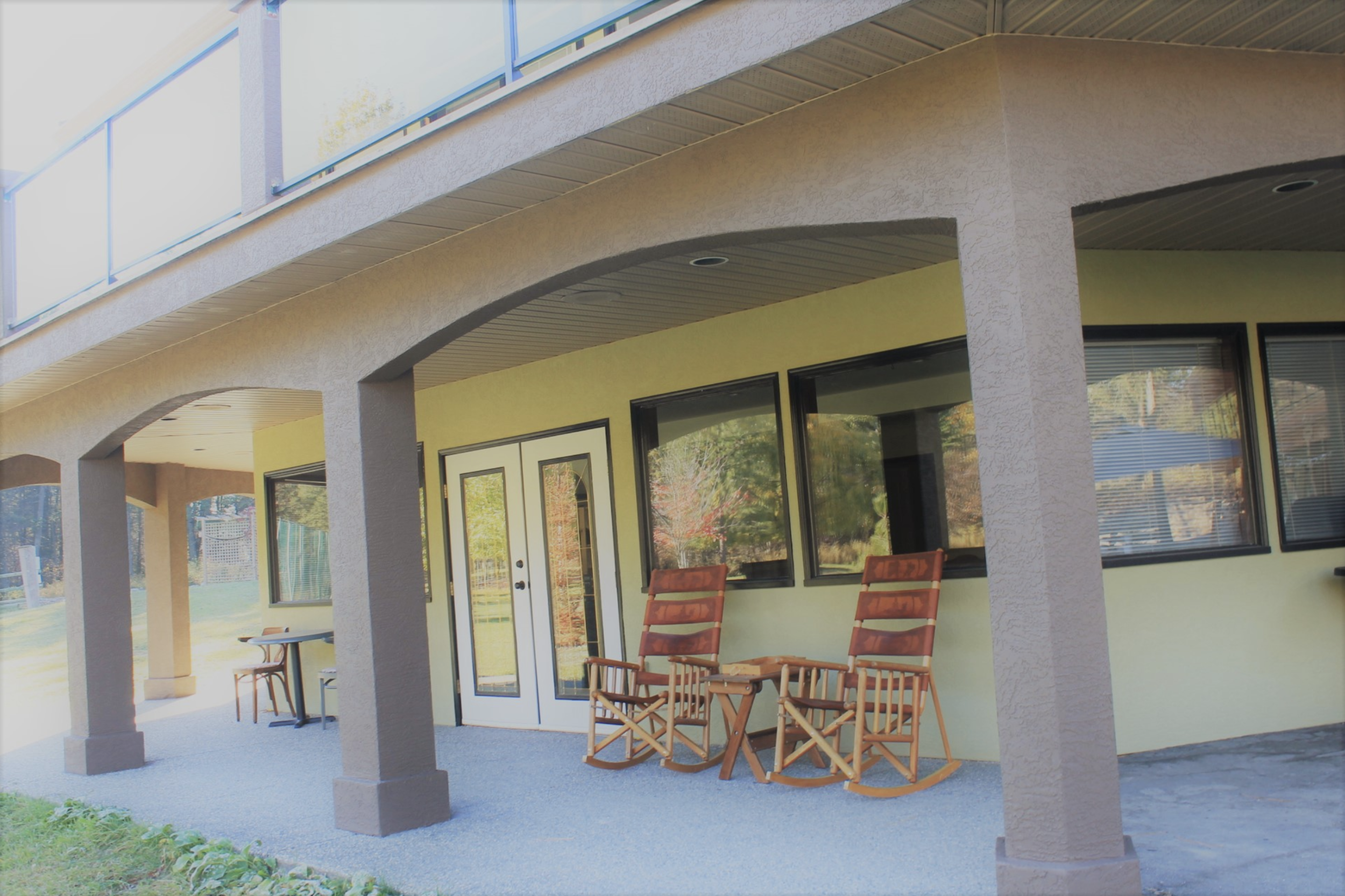 event space - 1,450 square feet of space including a prep kitchen and a large washroom. Enjoy watching the deer play in the meadow from your wraparound ground-level patio.