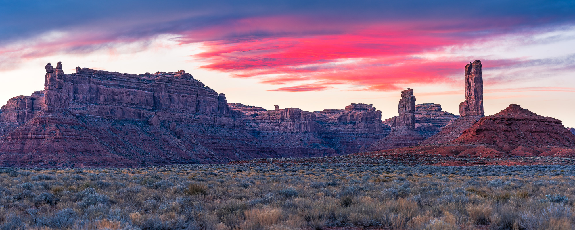 a cotton candy sunset over valley of the gods in bears ears national monument