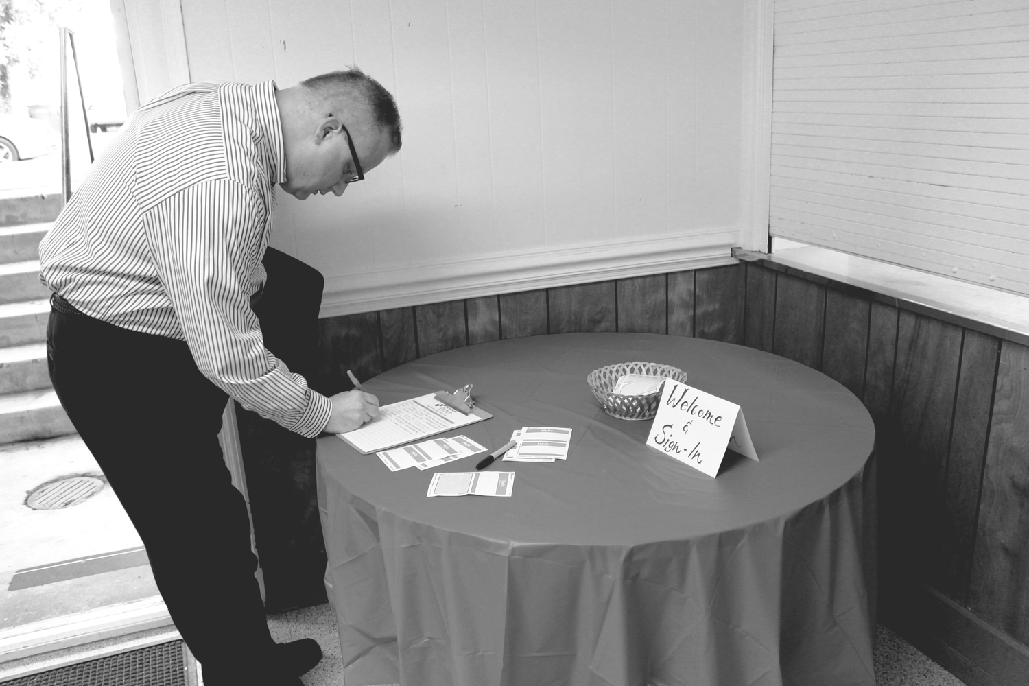Rev. Alan Felton of Resurrection UMC checking in and preparing for the morning's discussion on faith, business, and hiring