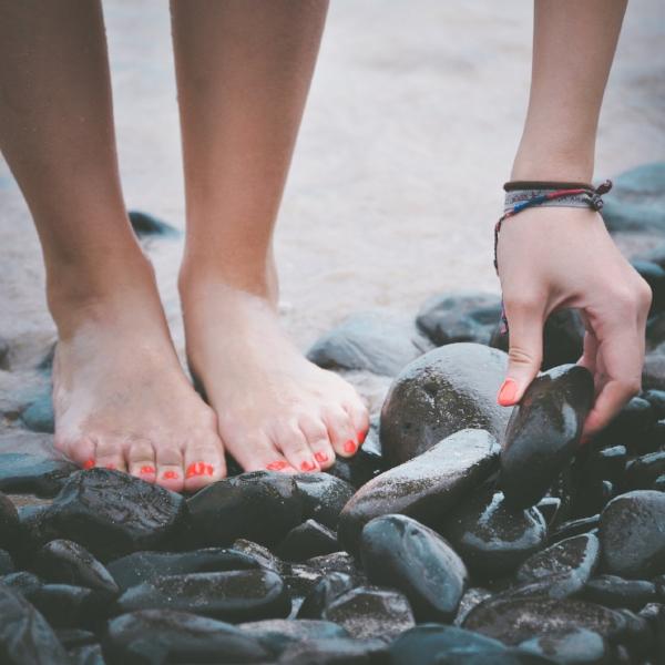 womens feet on wet stones - priscilla-du-preez-98675-unsplash.jpg