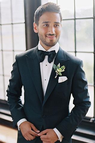 groom-wearing-custom-tuxedo.jpg