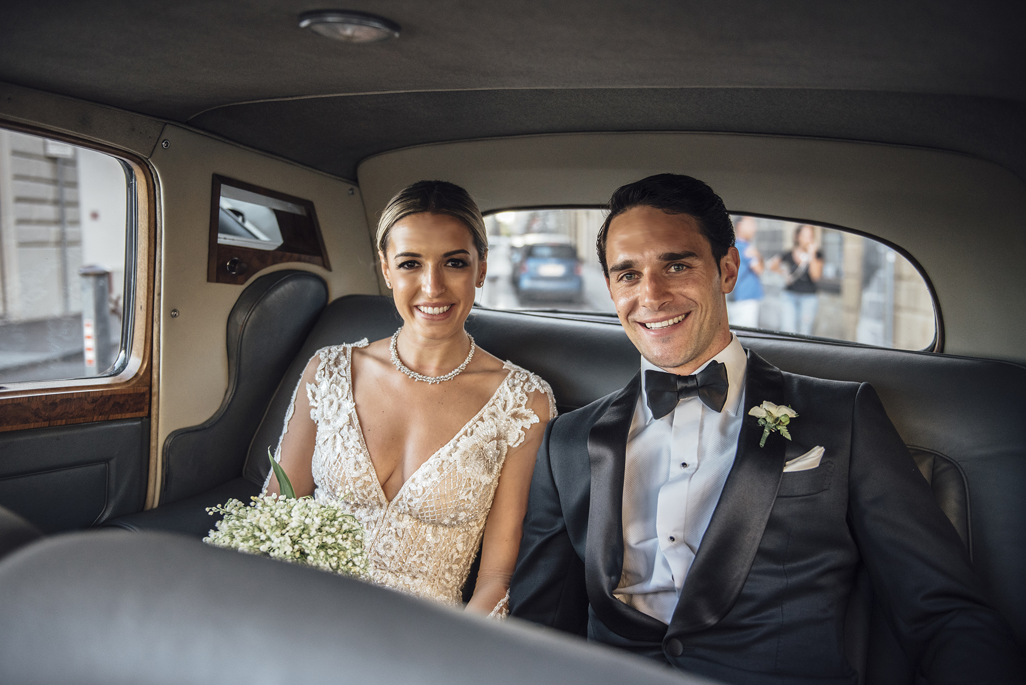 custom-wedding-couple-in-car.jpg