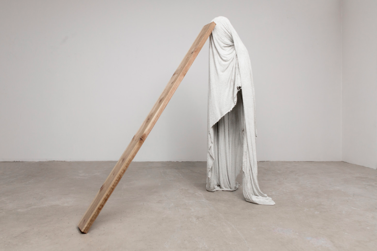 "The Pity (Plank), 2019. Concrete, cotton toweling, wood. 63 x 63 x 36""."