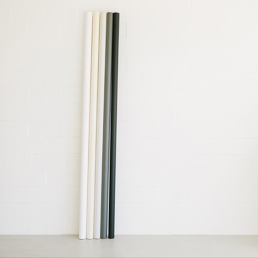white grey and black paper backdrops against white braick wall in white studio in dublin ca.jpg
