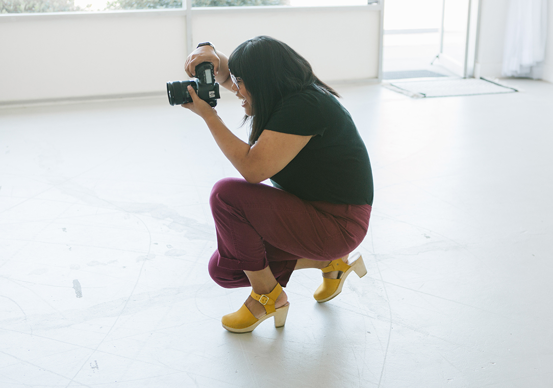photographer taking a picture in natural light studio in dublin ca.jpg