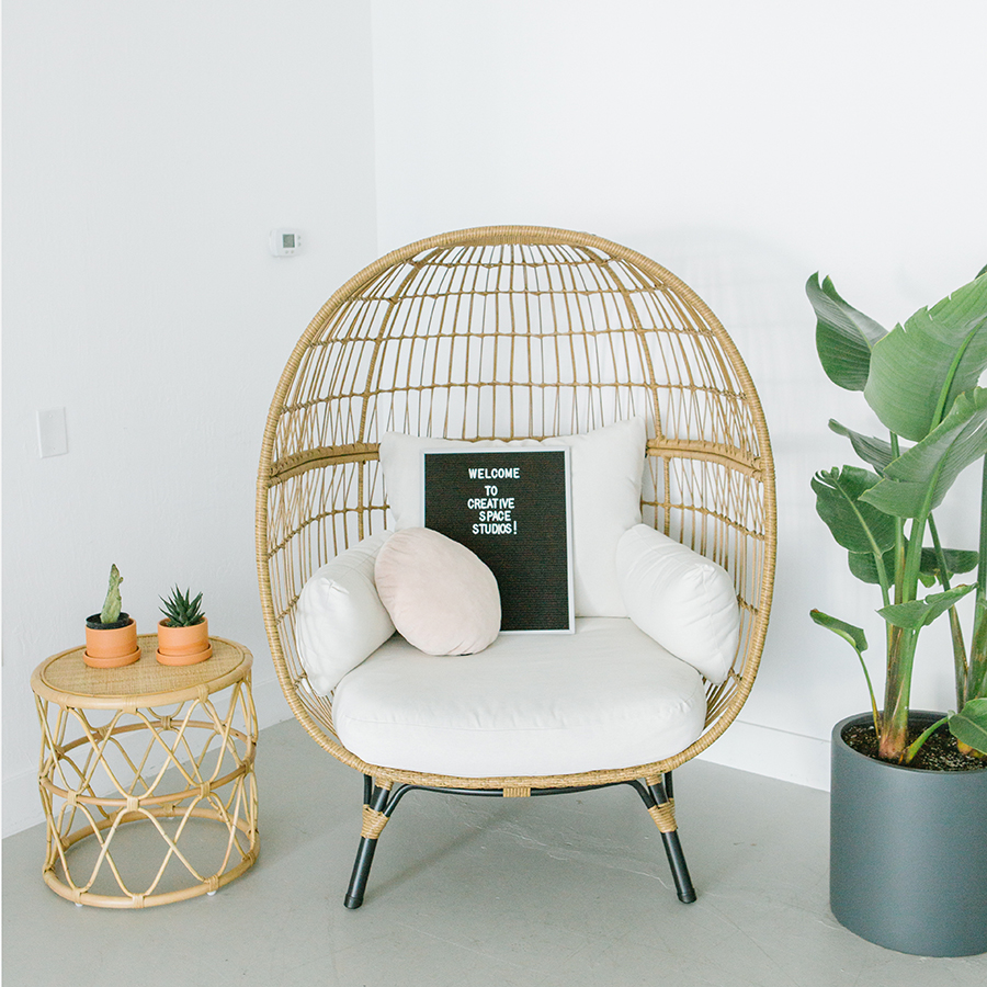 egg chair with letter board and tropical plant in a natural light studio in pleasanton ca.jpg