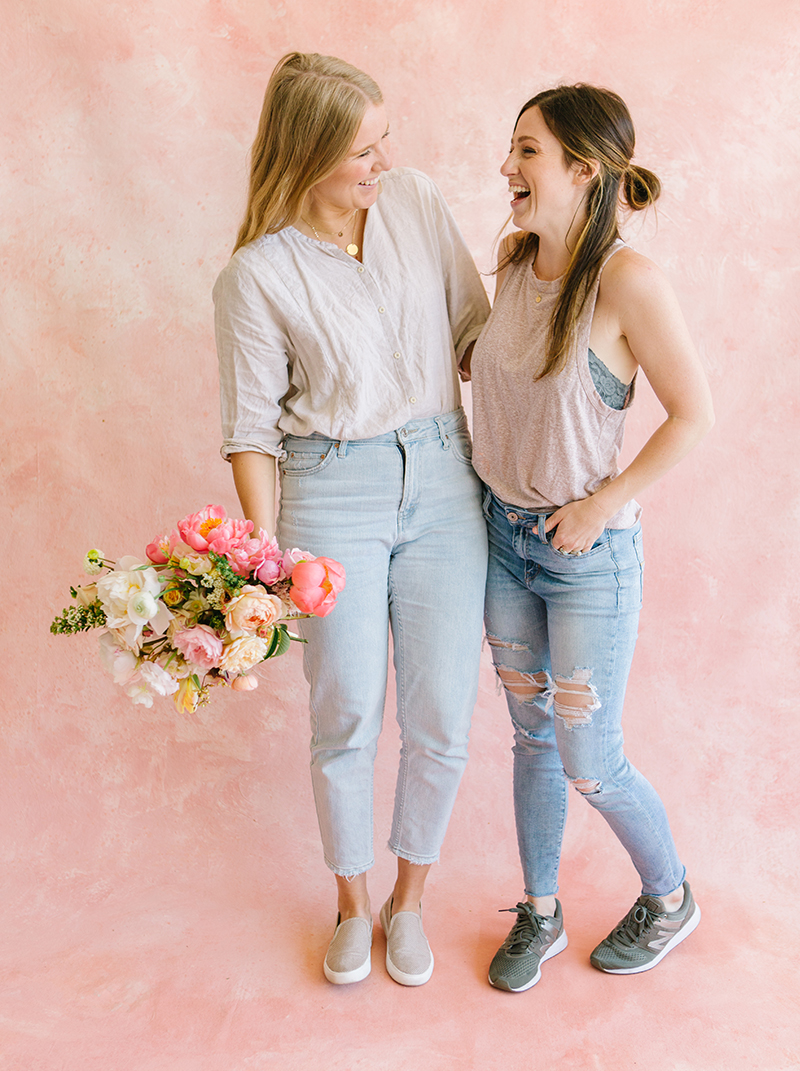 backdrop painter and florist posing in front of a custom painted backdrop in white rentable studio space in dublin ca.jpg