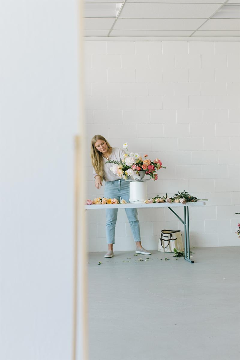 florist arranging flowers in white studio in danville ca.jpg