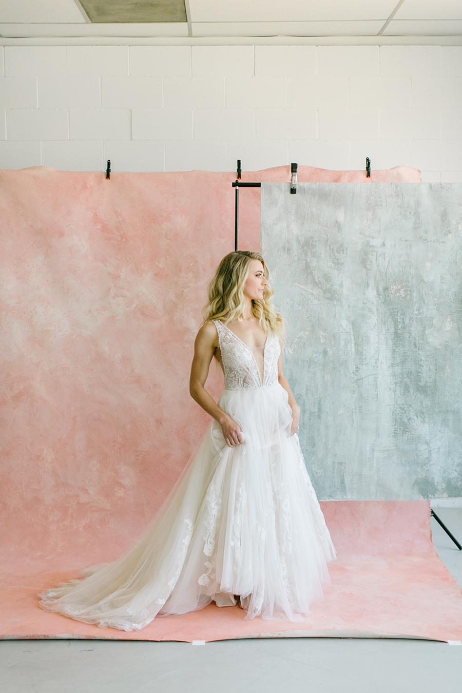 model standing in natural light studio on pink and grey custom painted backdrop in pleasanton ca.jpg