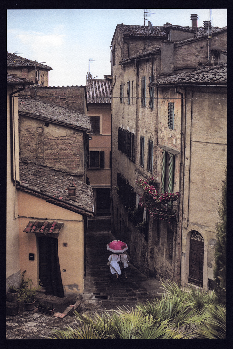 Two White Dresses and One Red Umbrella, Montepulciano, Italy, 2018