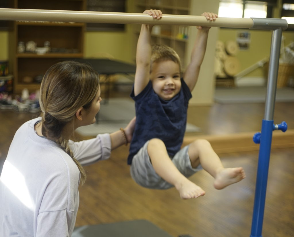 Gymnastics - During our school week, our students have a special time to explore their bodies in our gymnastics class. In our gymnastics studio, we have a variety of safe obstacles such as beams and poles that will help our students understand new ways to control their bodies within the space around them.