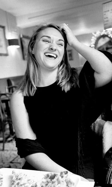 Sarah laughing in Paris, France