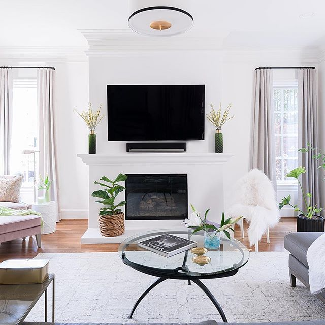What a difference surface finishes can make...from spec house to spectacular house!  #nashvillemakeover #nashvilleinteriors #fireplacemakeover #interiordesign #radredo. 📷@marycravenphotography
