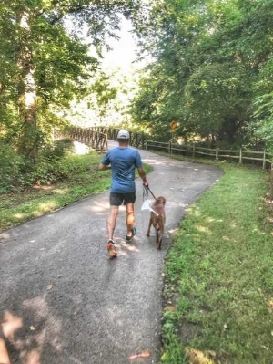Running on one of the beautiful Lenexa trails with my grand-dog Wrigley.