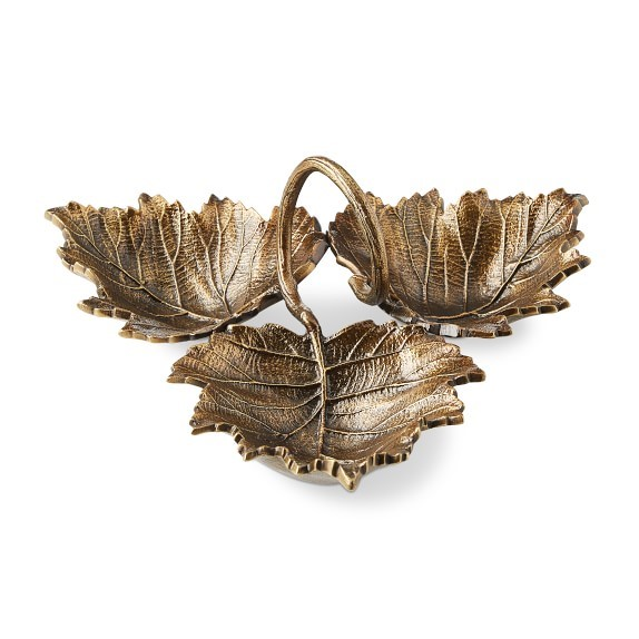 6. Antique Brass Three-Leaf Condiment Set - This three-leaf condiment set is the perfect holder to store your favorite fall candy and nuts for guests (and yourself) to snack on while bringing more warmth to the space.