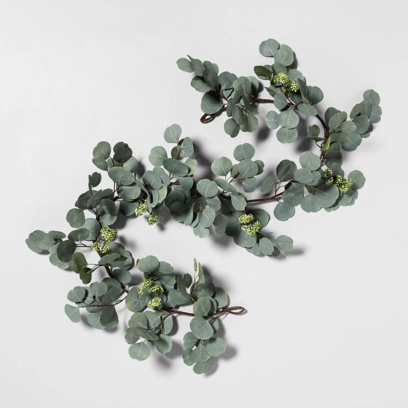 9. Eucalyptus Garland - While fall tends to focus on warmer colors, keeping hints of greenery around helps make your space feel bright and alive. Eucalyptus is an evergreen so it's also perfect for transitioning from summer to fall, and again from fall to winter.
