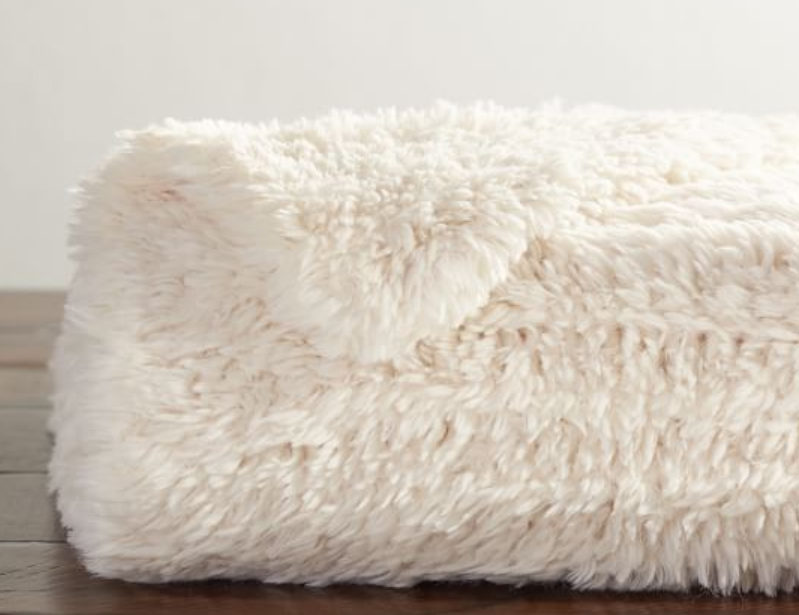 5. Faux Fur Knitted Throw Blanket - Perfect for snuggling up on the couch binge-watching your favorite tv show or reading a great book!