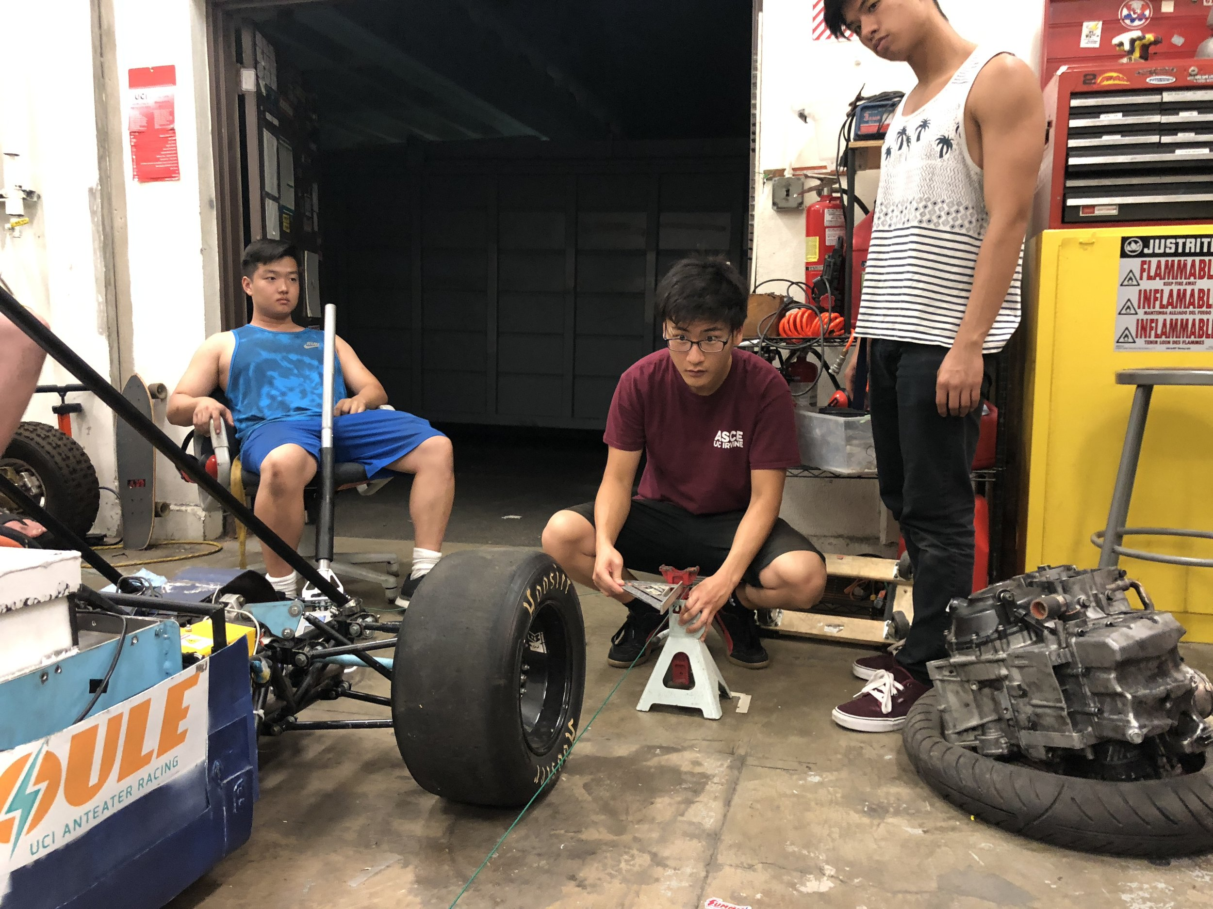 We set up a perfect square around Joule using jack stands and string leveled with the wheel hubs.  In Picture: Powertrain Lead Adam Yoneda (left), Engineer Daniel Kim (middle), Engineer Ron Cabuang (right)