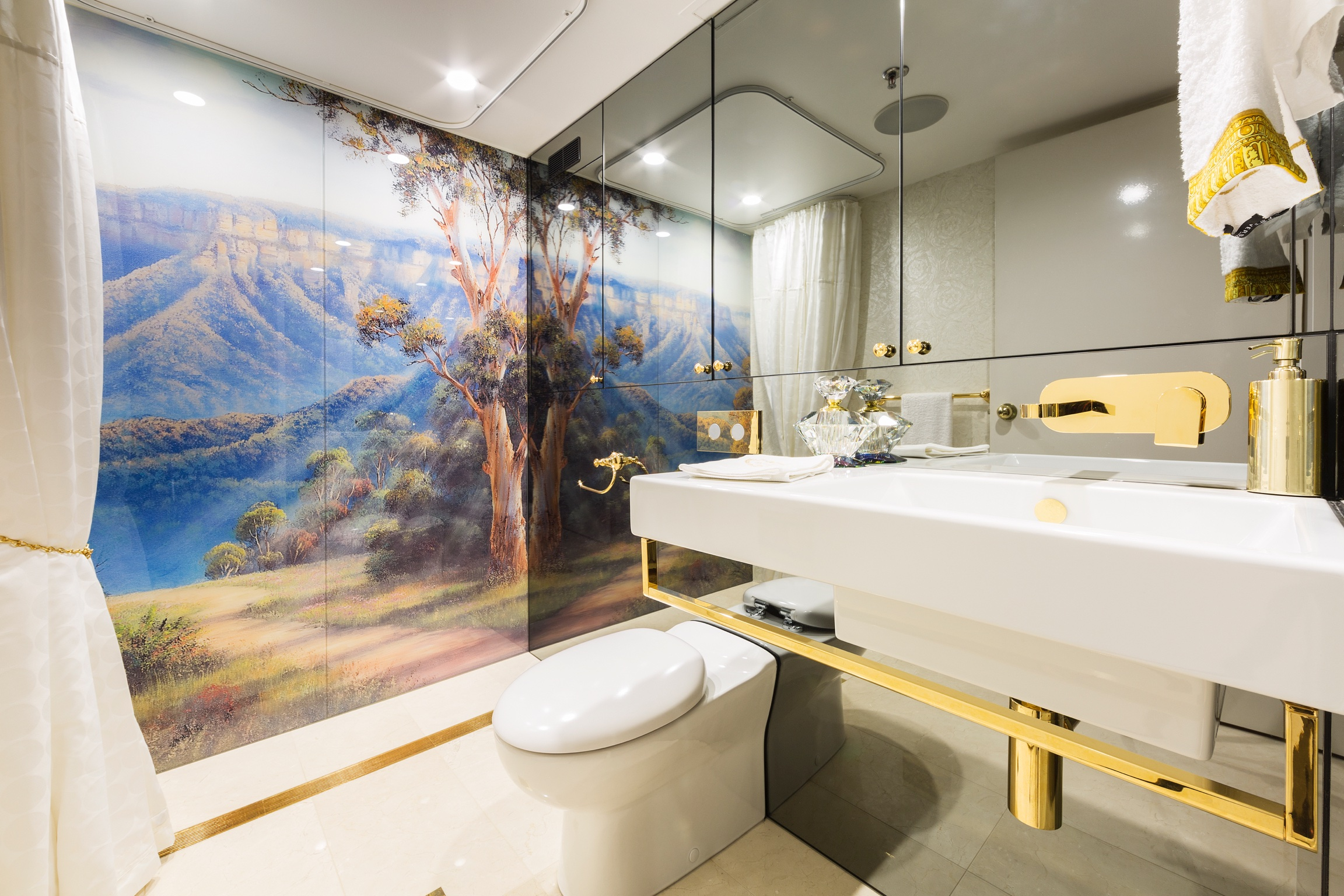 Digitally printed glass and toughened grey mirror cover the entire  wall surface in this amazing bathroom project.
