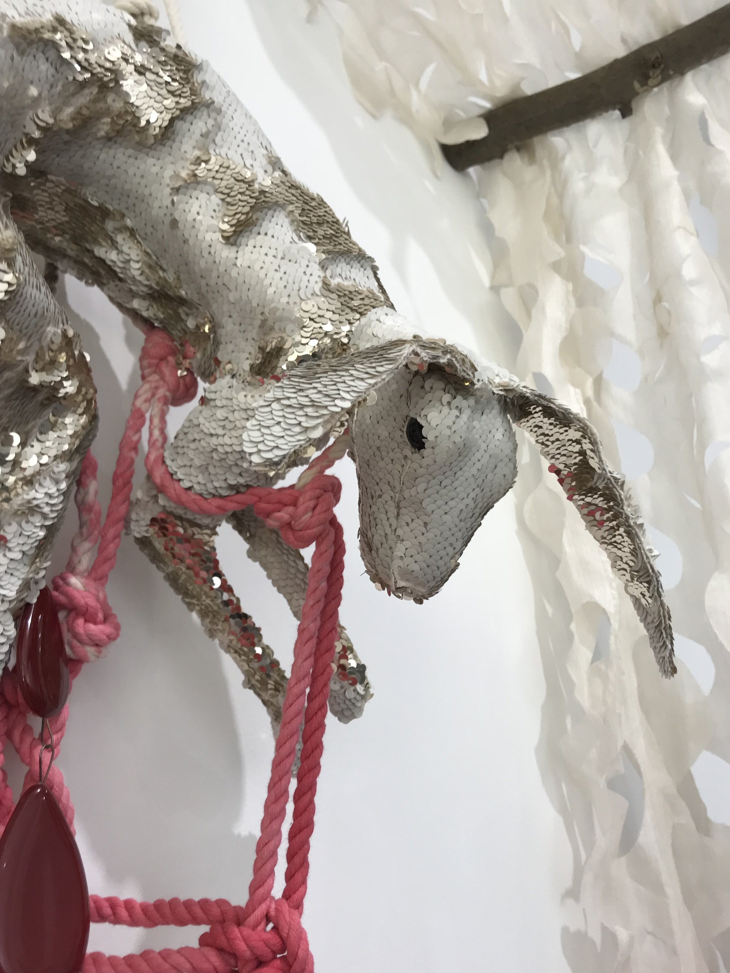 carolyn Hopkins  overkill  2018  kiln fused glass.over-dyed rope and silk, sequined fabric, taxidermy form, wood