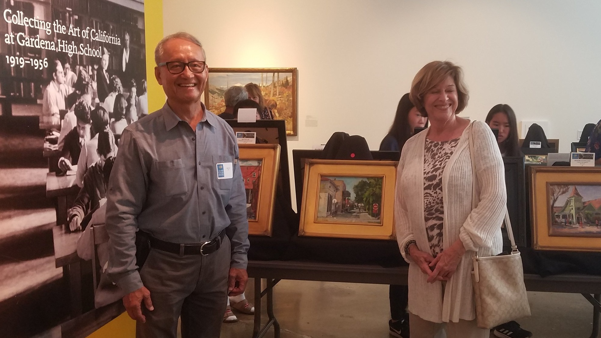 Walter with his artwork collector at Hilbert Museum of California Art at Chapman University on June 8, 2019. She purchased Walter's oil painting titled Alley Behind Sunkist Building.
