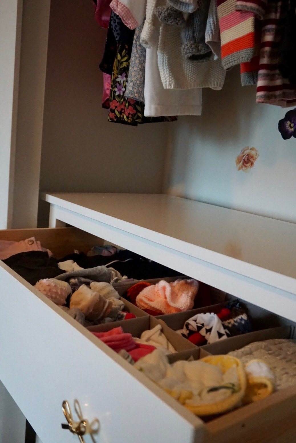 I also keep more clothes in her drawer. The top drawer houses everything that fits right now which includes onesies, t-shirts, jeans, leggings, bibs, hair accessories, socks, PJs and sleep sacks.