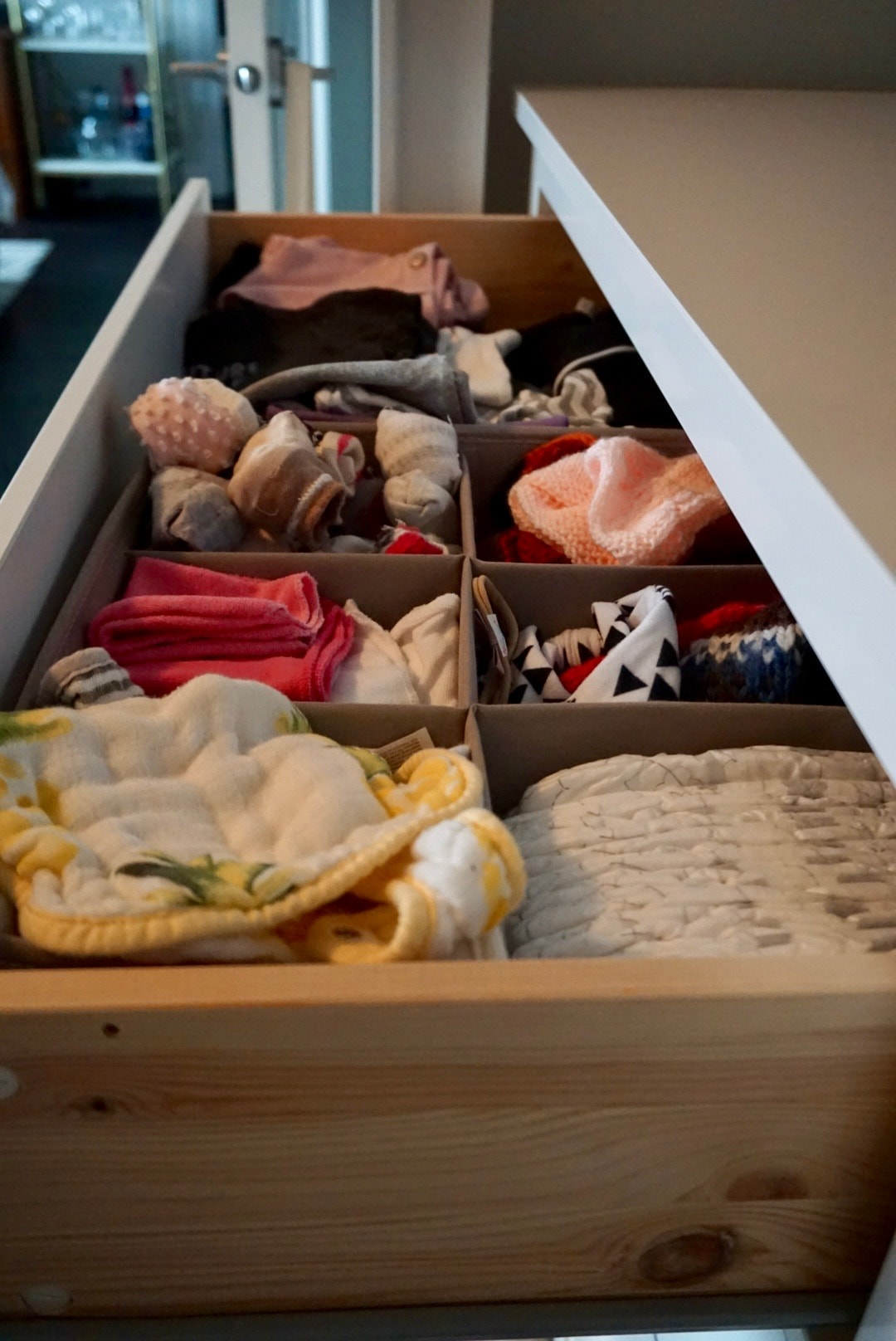 Everything in the first drawer has items for 6 to 12 months. The second drawer is 12 month+ clothing and we use the bottom drawer for storage purposes.