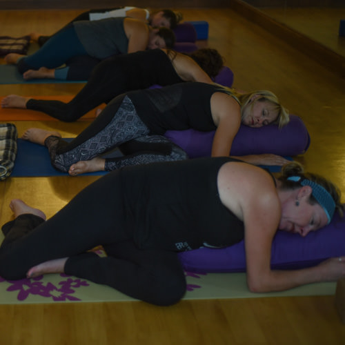 Restorative Yoga - Students will journey through a series of passive, meditative-type postures. Each asana will be held for several minutes to encourage a deeper sense of relaxation to the mind and muscles.