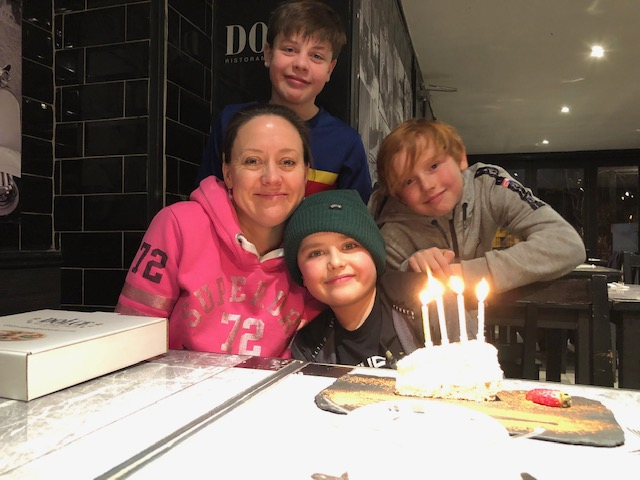 Me and my three boys celebrating my youngest's 8th birthday
