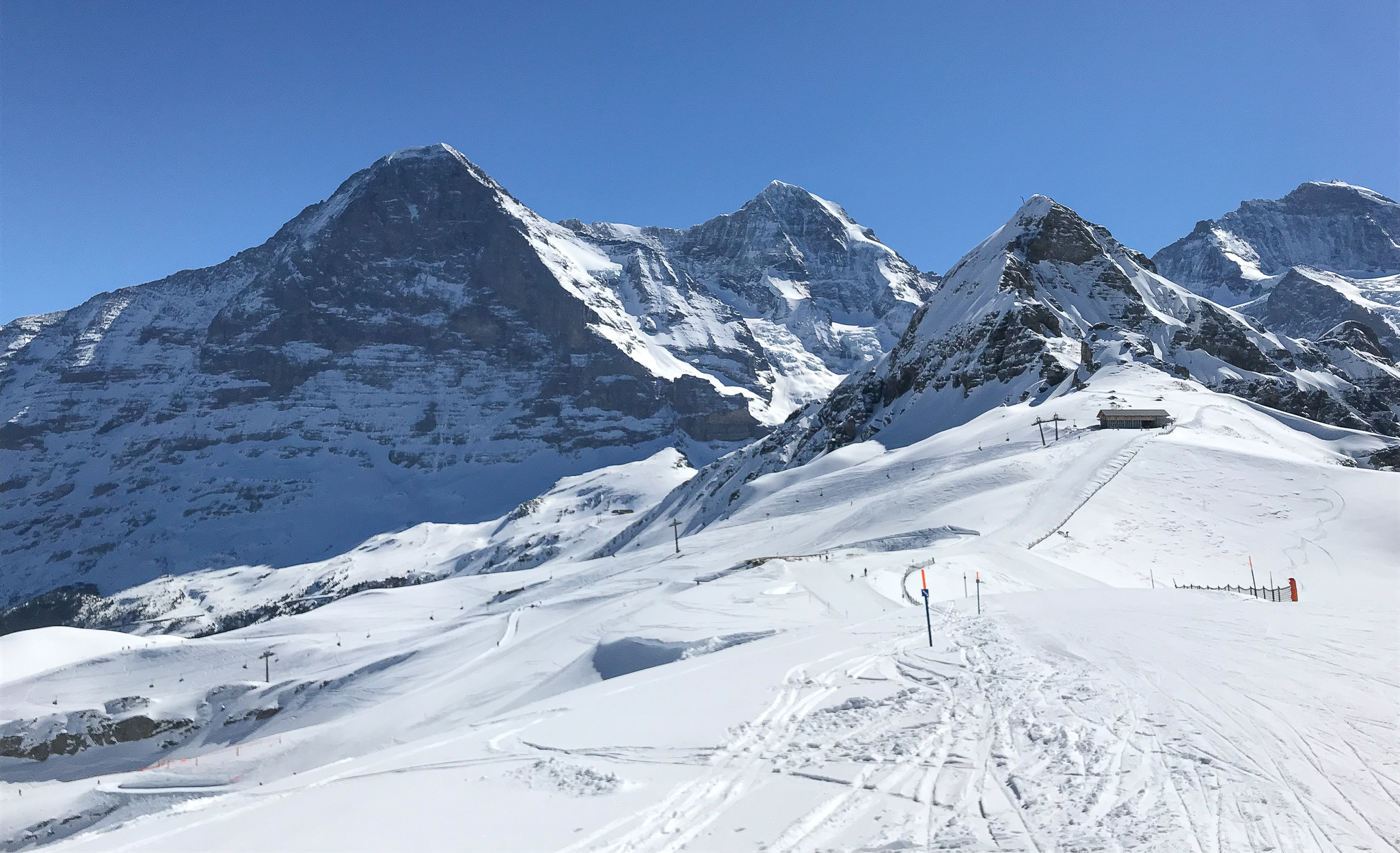 TO THE LEFT IS THE EIGER NORTH FACE, FOLLOWED BY THE MÖNCH AND JUNGFRAU IN THE BACKGROUND.