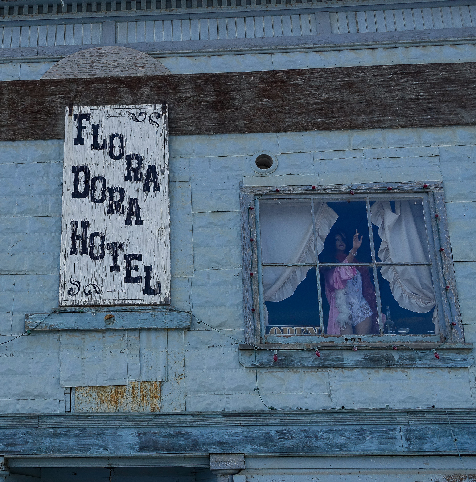 """IN THE MID-30S, THE FLORA DORA HOTEL WAS THE PROPERTY OF MADAME RUBY SCOTT. THE PRICES FOR """"LIBERTY"""" OR """"CECILE"""" WERE $5 A TIME OR $20 FOR THE NIGHT. A DREDGERMAN EARNED $5 FOR A 12 HOUR SHIFT."""