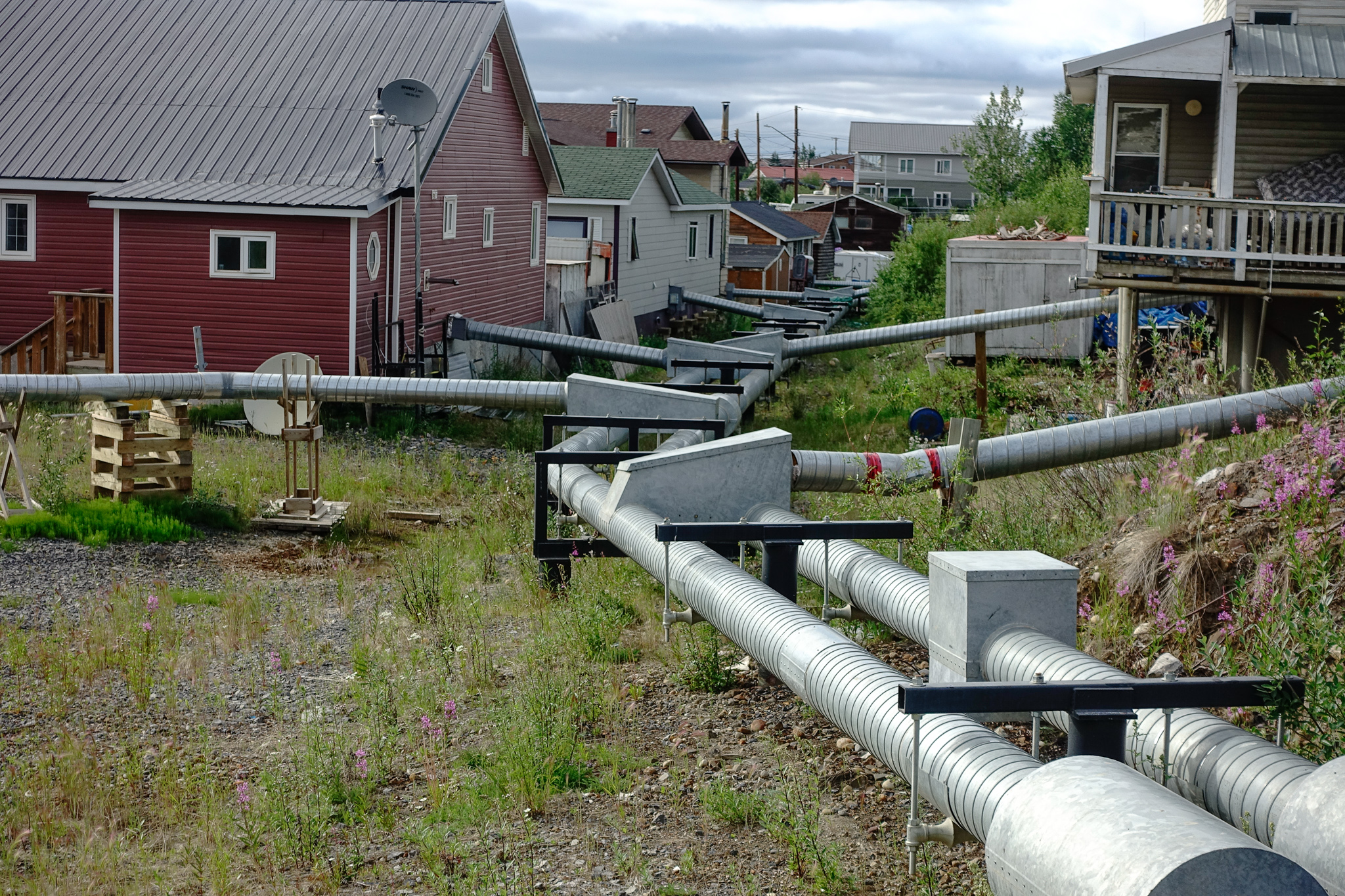 INUVIK PLUMBING. PERMAFROST MEANS THE PIPES REMAIN ABOVE GROUND (AND WELL INSULATED).