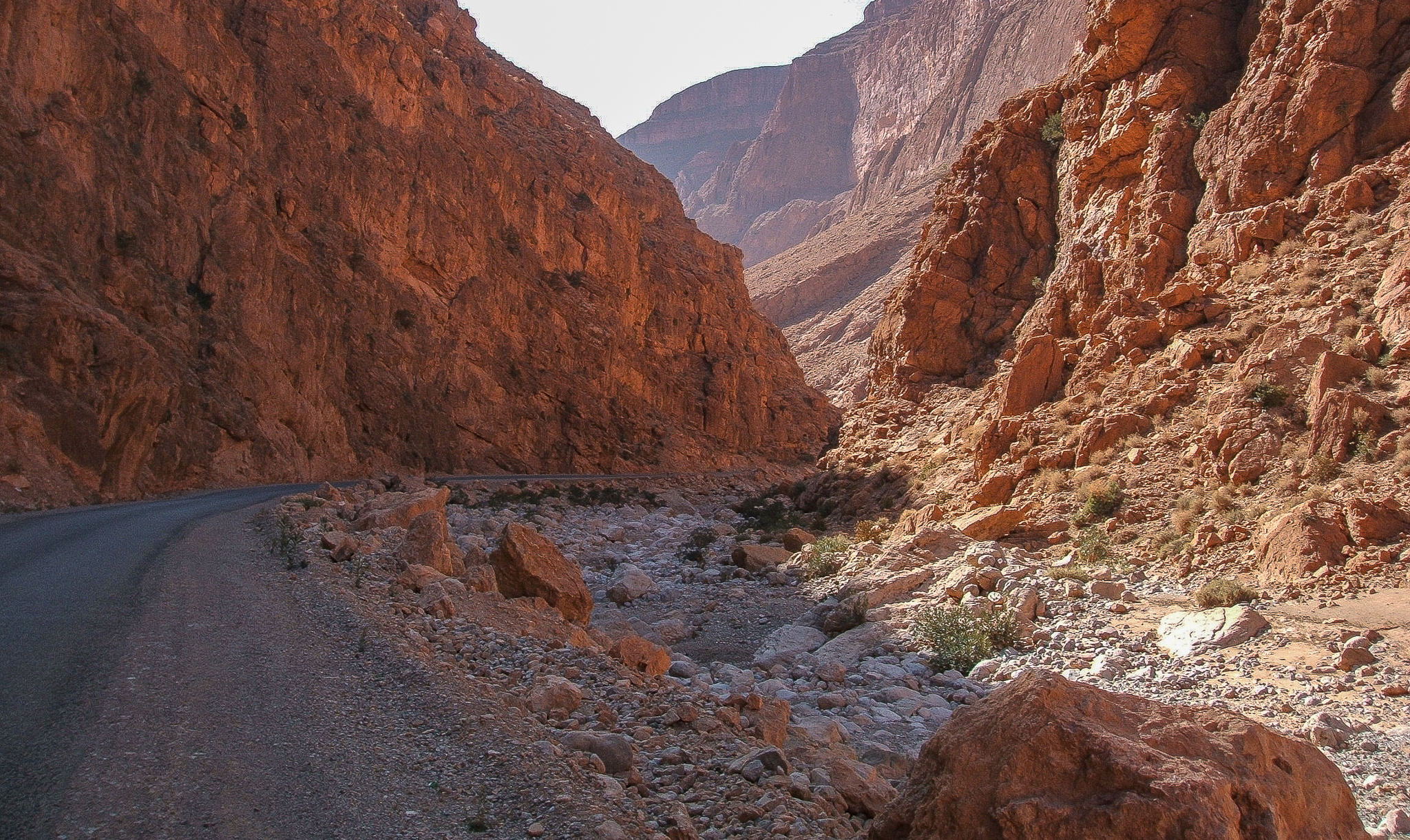 THE ROAD CUTS THROUGH THE CANYONS IN THE HIGH ATLAS MOUNTAINS.