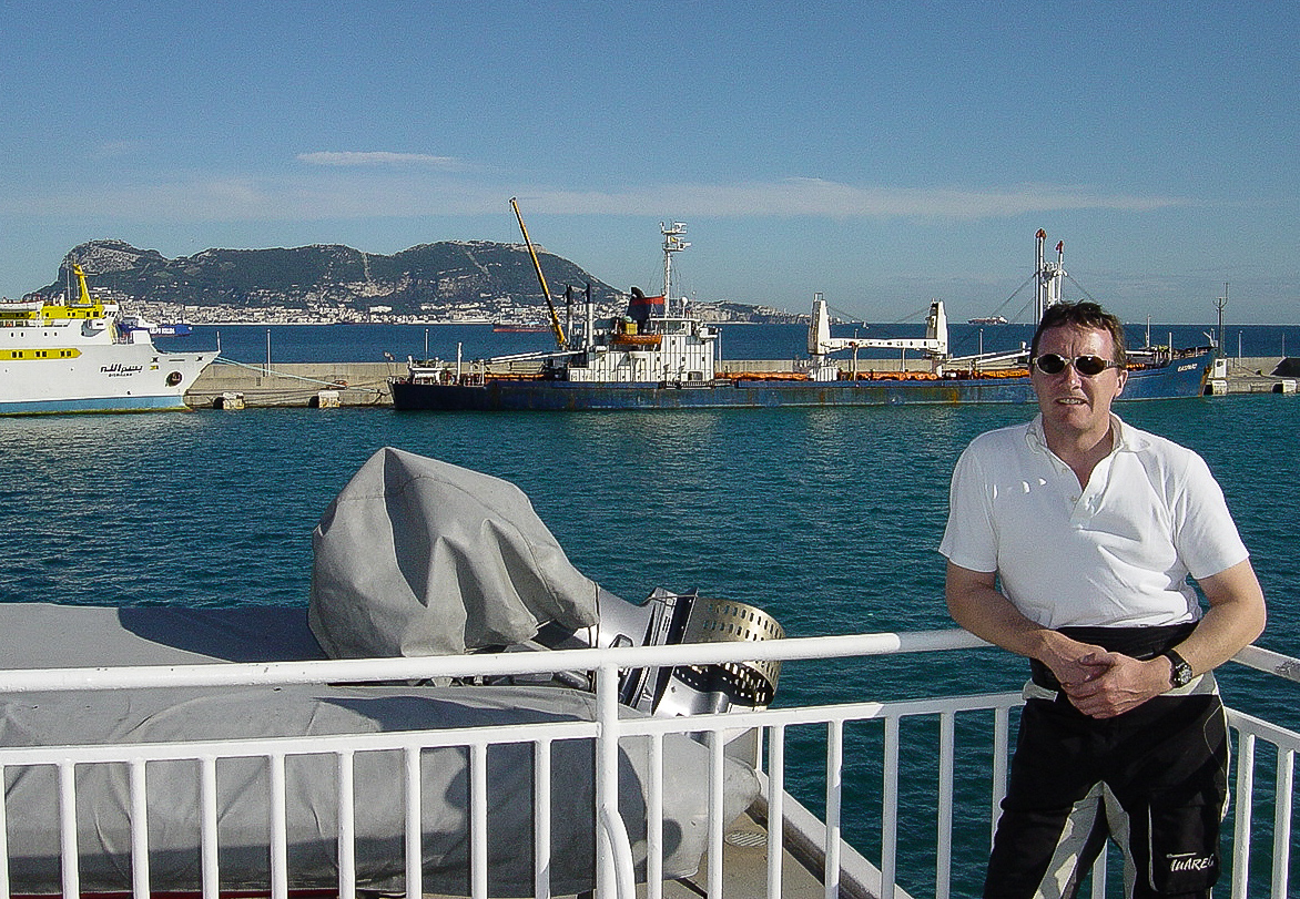 MAKING THE FERRY CROSSING FROM ALGECIRAS TO THE SPANISH ENCLAVE OF CEUTA, ON THE NORTH COAST OF AFRICA. IN CEUTA THE LAST VESTIGES OF EUROPEAN CULTURE ARE OVERWHELMED BY THE EXOTIC MAGHREB. GIBRALTAR, ONE OF THE PILLARS OF HERCULES, LIES IN THE BACKGROUND.