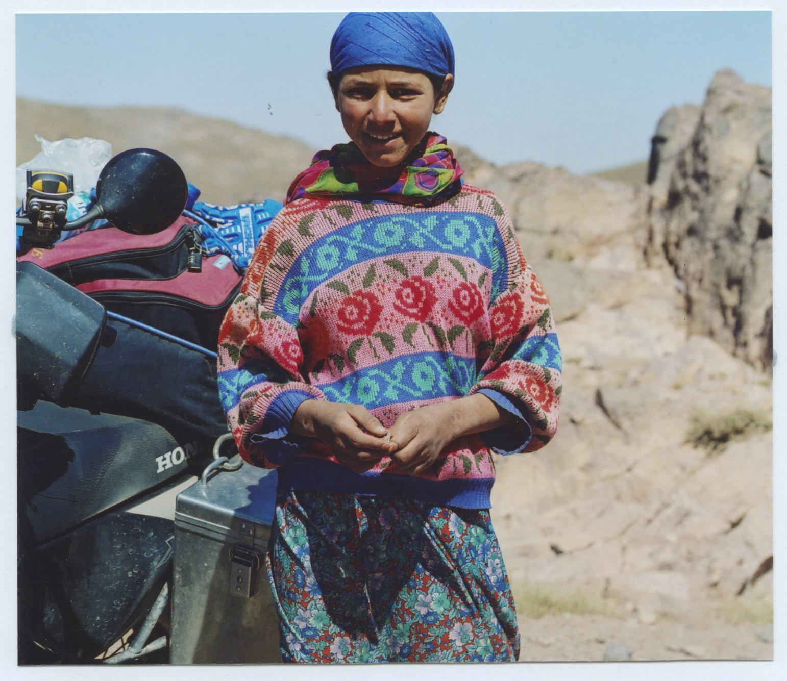 A BERBER GIRL SELLING ROCKS NEAR TIOUIT. I'D BEEN BOUNCING OVER THEM ALL DAY LONG. IT WAS A HARD SELL.