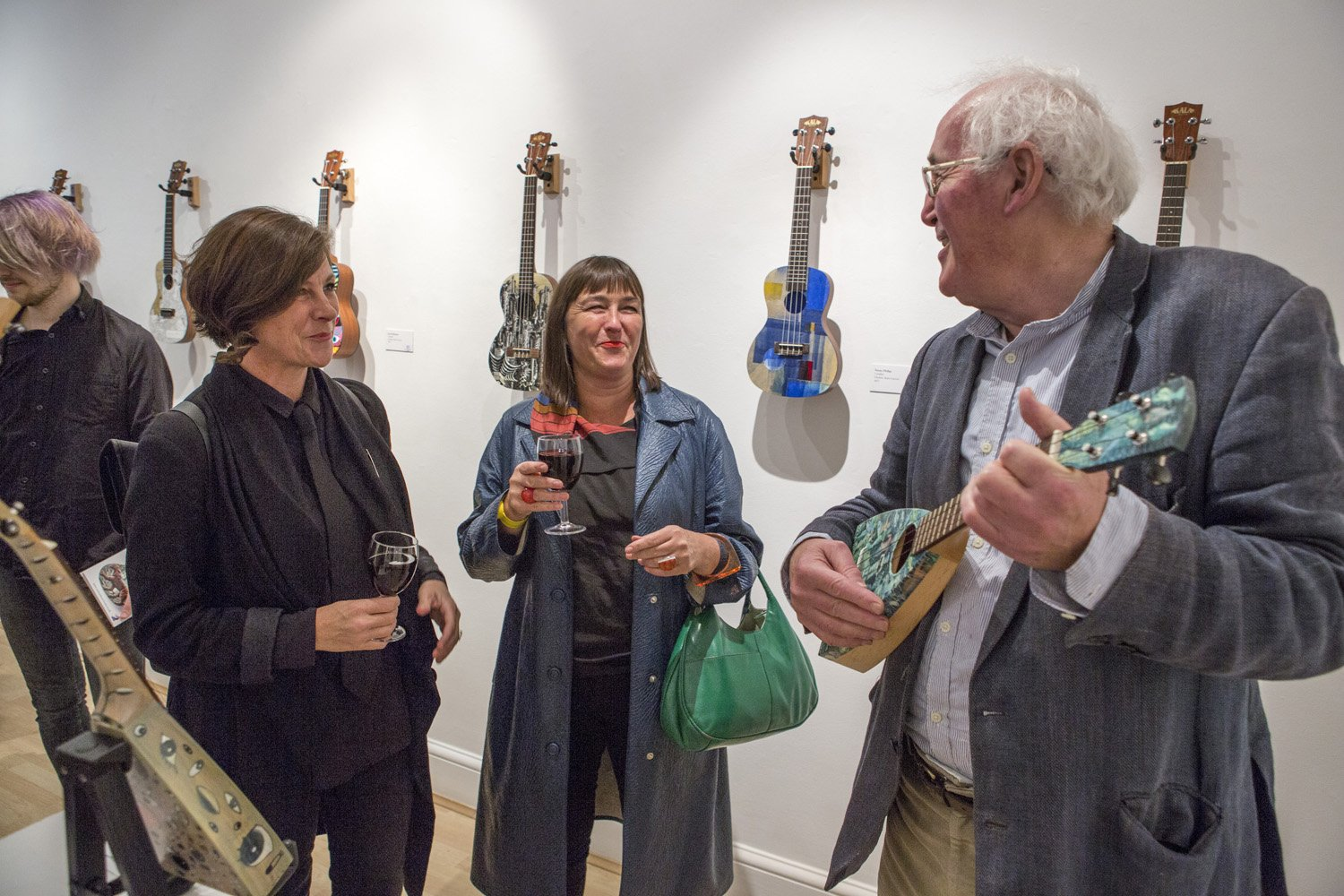 Mick Rooney RA plays his Uke to members of The Ukulele Orchestra of Great Britain