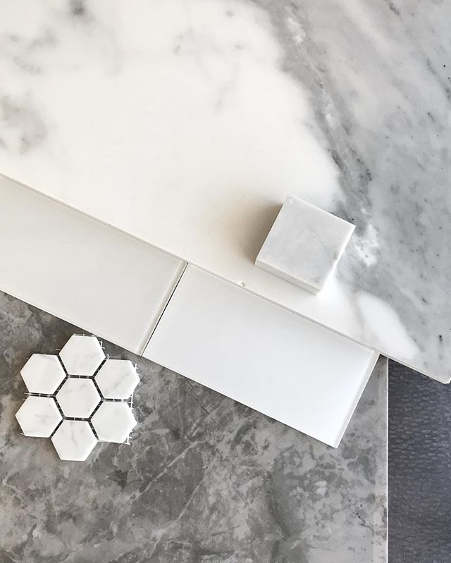 Another day, another bathroom project! This one steps away from a traditional subway tile towards a glass subway, a better fit for the polished marble tile floors and tub surround.
