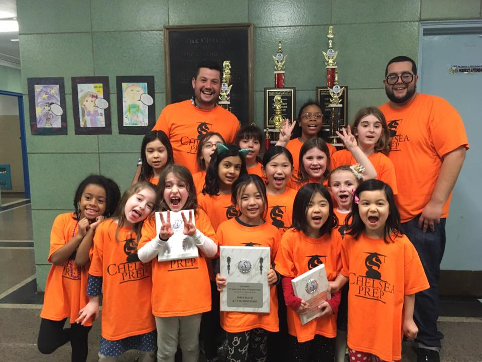Program Director Russell Makofsky, left, and Coach Angel Lopez, right, with 2017 PS 33 Girls' Chess Team (missing 2 players) . DNAinfo/Maya Rajamani