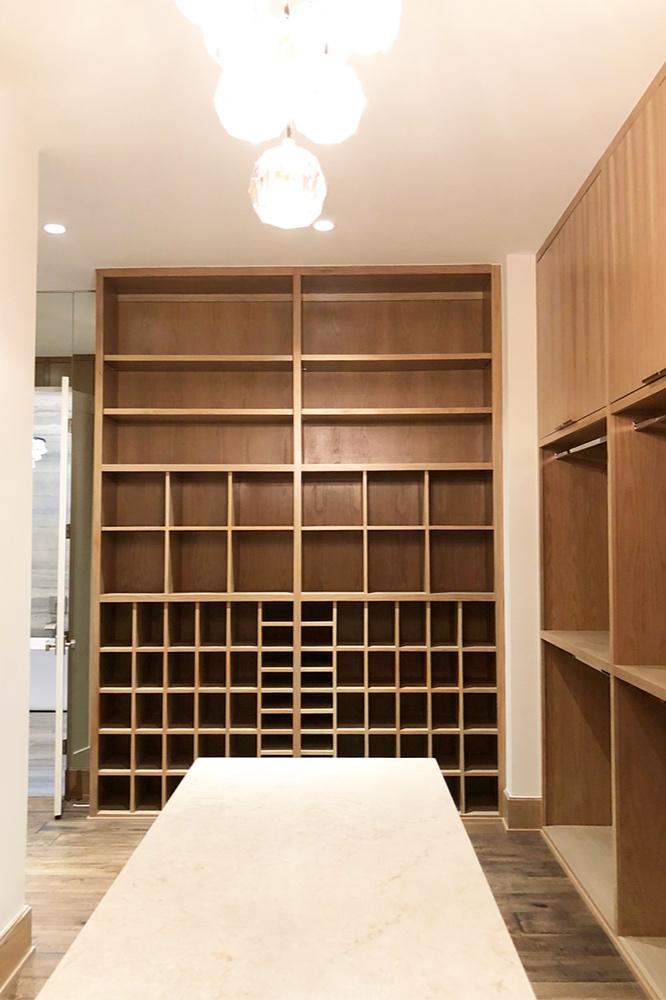 A contemporary oak closet shoe storage design by Habitat Roche