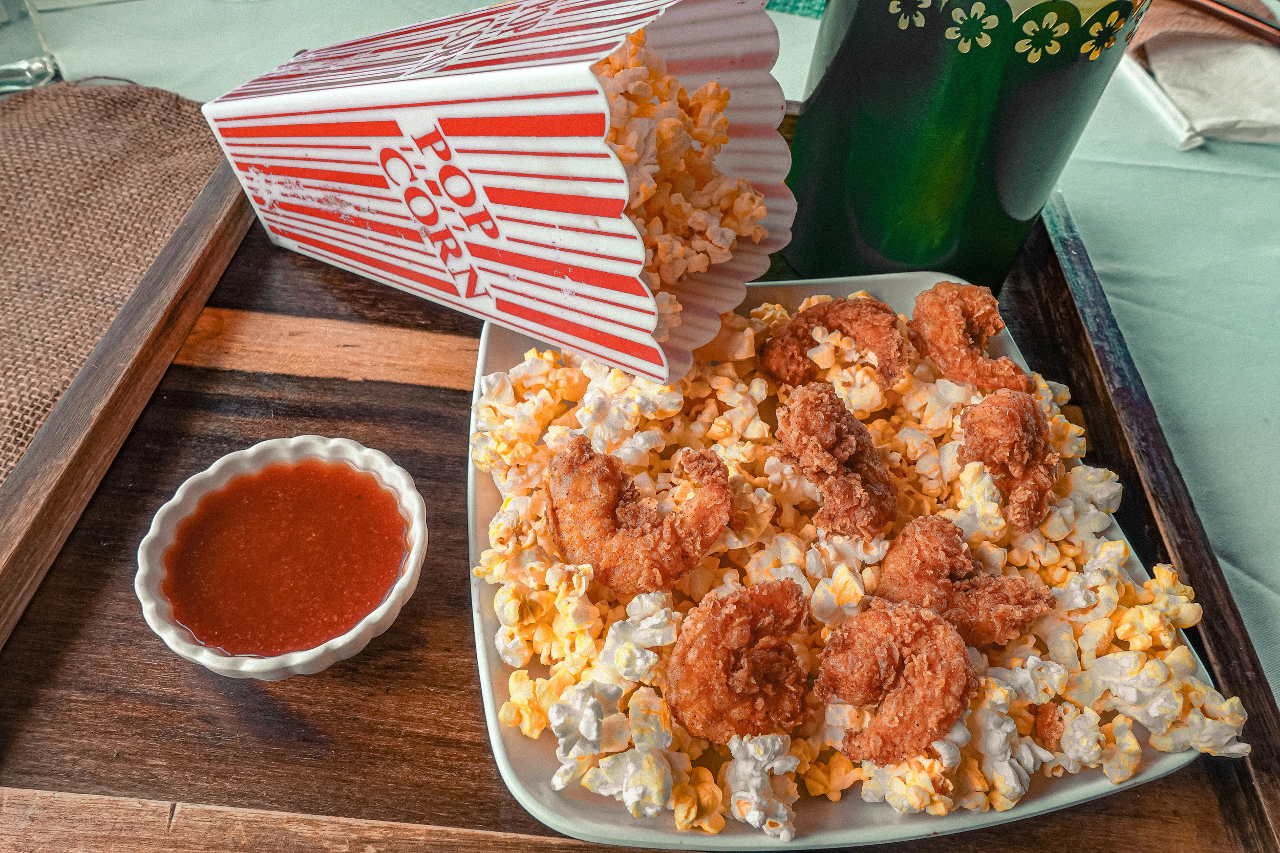 POP CORN SHRIMP - on a bed of popcorn served with homemade barbecue sauce.