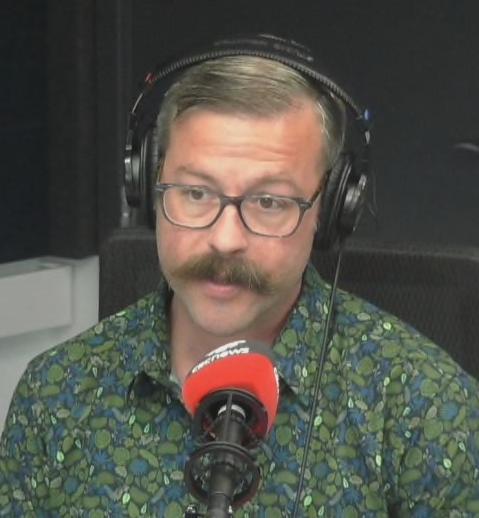 John-Paul being interviewed at CBC Radio's Calgary studio