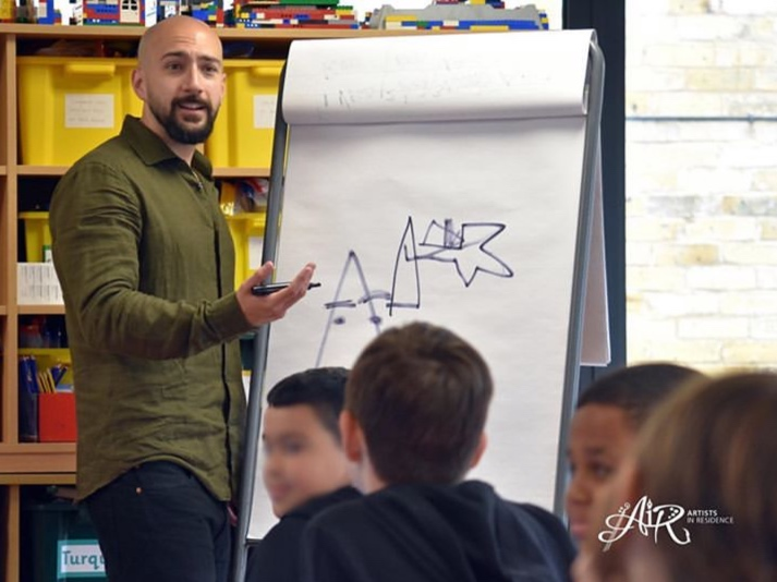 Developing comic ideas on the spot with a class at Fleet Primary School, as part of the Artist in Residence scheme. (www.artistsinresidence.org.uk)