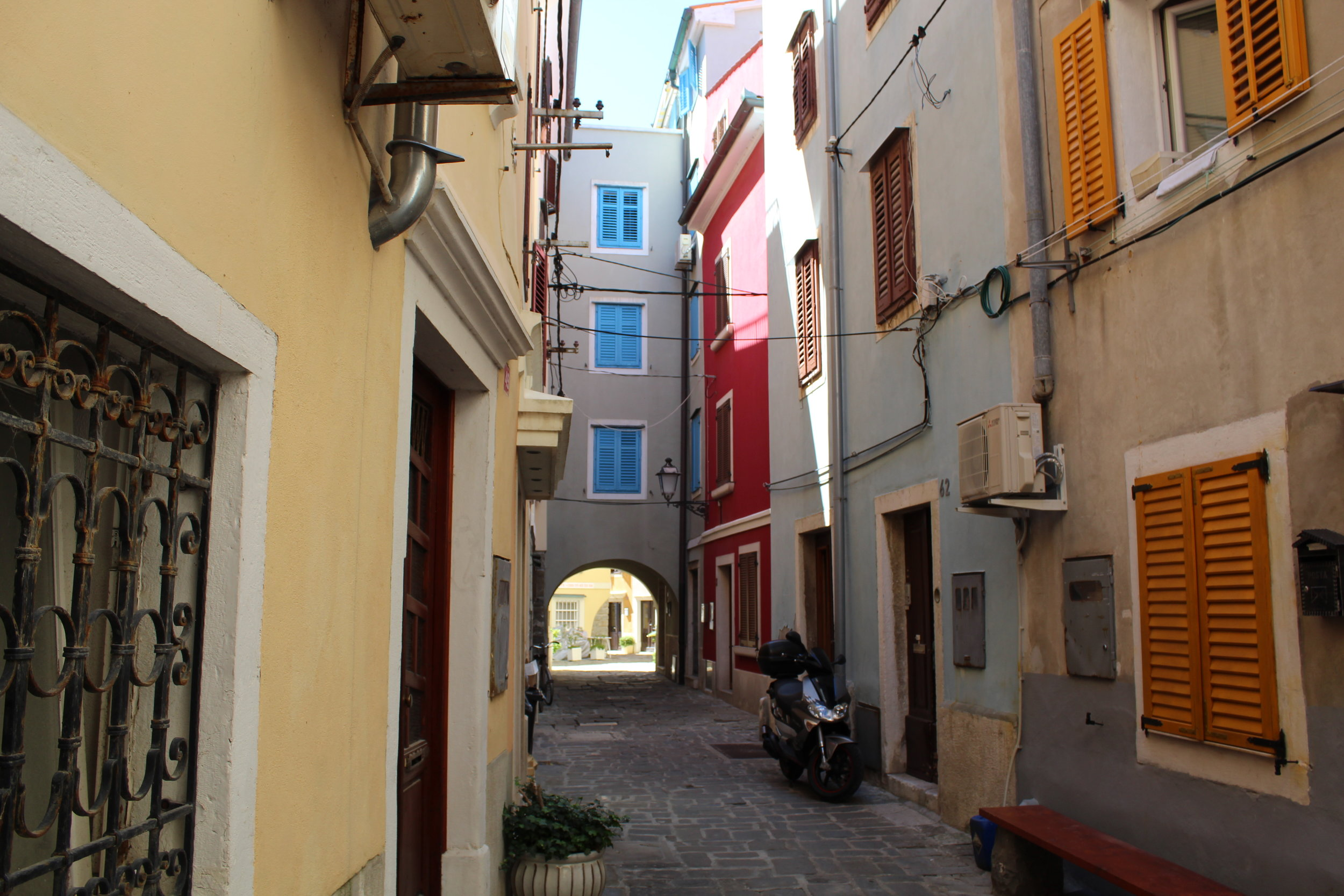 Typical narrow street view through Piram