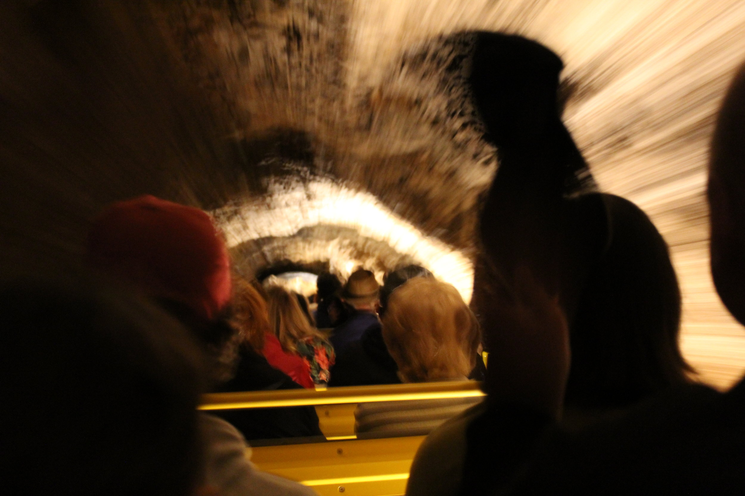 Travelling down into the cave by train